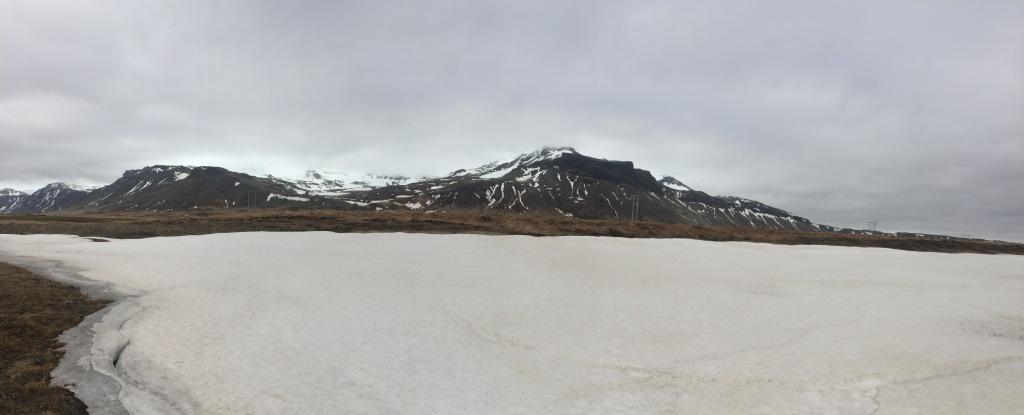 The frozen lake next to a small mountain